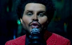 Navigation to Story: The Weeknd's New Look: Real or Fake?